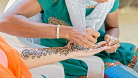 Master Draws Patterns with Henna on Bride Fingers in India stock video