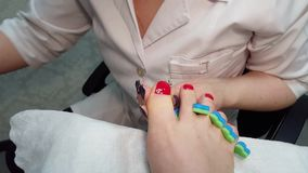 Master Draws a rose on thumb nail - pedicure stock video