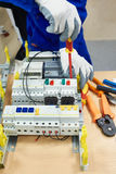Master electrician collects electrical system Stock Images
