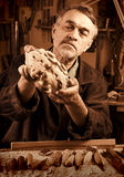 Master examines wood carvings, the carpenter checks the finished royalty free stock photo