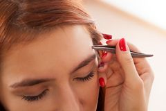 Master on the eyebrows working stock photography