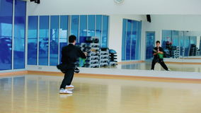 The master fighting with sword with invisible opponent in the gym stock video