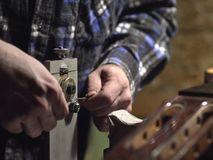 Free Master Gives The Correct Form Of Frets. Royalty Free Stock Photography - 145110397