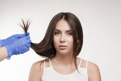 Master hairdresser procedure oil hair treatment for woman. Concept spa salon stock image