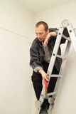 Master with a hammer. To make repairs in the apartment Royalty Free Stock Photography