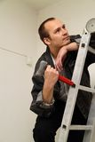 Master with a hammer. To make repairs in the apartment Stock Photography