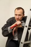 Master with a hammer. To make repairs in the apartment Royalty Free Stock Photo