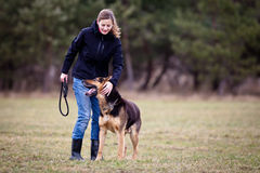 Master and her obedient dog Stock Photography