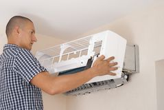 Installation of Air Conditioning royalty free stock photography