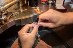 Master jeweler produces a gold ring Royalty Free Stock Images