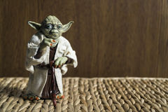 Master Joda Action Figure from The Star Wars Movie. Istanbul, Turkey - October 29, 2016: Master Joda action figure from The Star Wars Movie standing on a wicker Royalty Free Stock Image