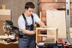 Master joiner skins stool stock photography