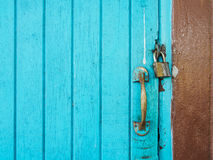 Master key and handle lack blue door with copy space Royalty Free Stock Photos