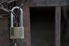 Master key lock with chain on steel gate royalty free stock photo