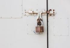 Master key is lock on white steel door Royalty Free Stock Photos