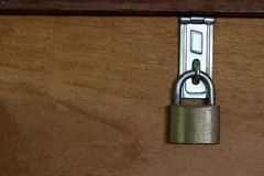 Master key is lock on wood background, blank on left background for message royalty free stock images
