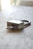 Master key unlocked on wooden board. Silver master key unlocked on wooden board Stock Photos