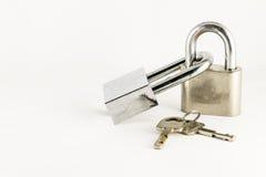 Master keys. Isolated coulple master keys locked together on white background Stock Photo