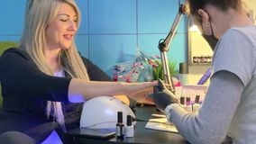 Manicure. Master makes a manicure client stock footage