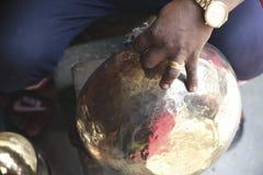 The master makes a Tibetan cup KATMANDU stock image