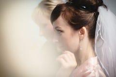 Master making make up for girl bride. Kirov, Russia - 24 November, 2017: Master making make up for girl bride indoors Royalty Free Stock Image