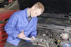 Master mechanic check a car Stock Photos