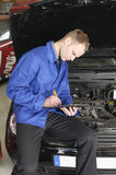 Master mechanic check a car Royalty Free Stock Photography