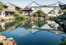 Master of Nets Garden Wang Shi Yuan, Suzhou, China. Suzhou, China - Nov 5, 2016: A tranquil traditional Chinese architectural scene, featuring landscaped trees stock images
