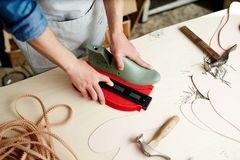 Work of cobbler. Master of own cobbler workshop doing his work by large table royalty free stock photos