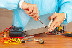 Master parses electronic device for checking in service workshop Stock Photos