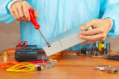 Master parses electronic hardware for checking in service workshop Stock Images