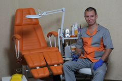 Master of pedicure and his equipment. Master of pedicure is waiting client Royalty Free Stock Image
