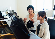Master piano student explains  important things Stock Photos