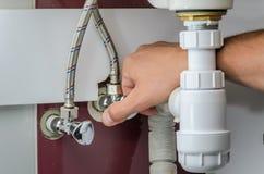 Master plumber repairs water faucets stock images