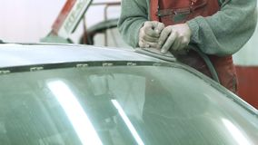 Master polishes the car body before painting stock footage