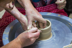 Master potter holds a lesson for modeling Stock Image