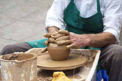 Master Potter and a Pot of Clay Royalty Free Stock Photography