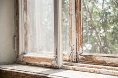Master removes old paint from window with heat gun and scraper. Closeup. Stock Image