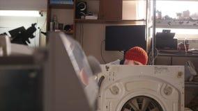 Master on repair washing machine. stock video footage
