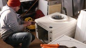 Master on Repair Washing Machine. stock video