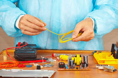 Master repairing electronic hardware in service workshop Stock Images