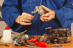 Master repairing parts of the automobile engine Stock Photo