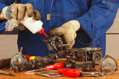 Master repairing parts car engine in the workshop Stock Image