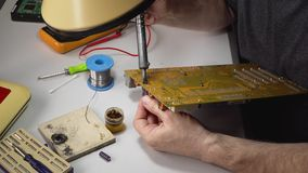 Master repairs chip. Technician electronic soldering and repairing computer chip stock video footage