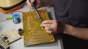 Master repairs chip. Technician electronic soldering and repairing computer chip stock video