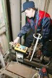 Master repairs the lift Royalty Free Stock Image