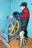 Master repairs the lift Stock Photos
