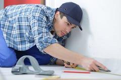 Master repairs room Stock Photo