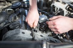 The master repairs under the hood of the car Stock Images