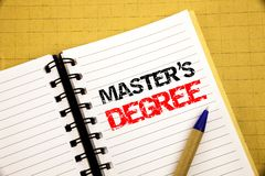 Master s Degree. Business concept for Academic Education written on notepad with copy space on old wood wooden background with pen royalty free stock photography